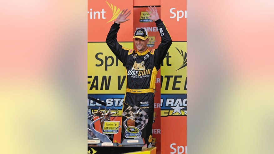 Josh Wise waves after being announced as the winner of the fan vote after the NASCAR Sprint Showdown auto race at Charlotte Motor Speedway in Concord, N.C., Friday, May 16, 2014. By winning the fan vote, Wise gets the last spot in Saturday's All-Star race. (AP Photo/Chuck Burton)