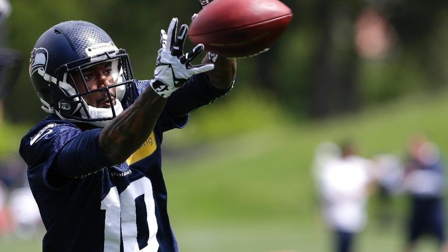 Seattle Seahawks rookie wide receiver Paul Richardson makes a catch, Friday, May 16, 2014, during an NFL football rookie minicamp in Renton, Wash. (AP Photo/Ted S. Warren)
