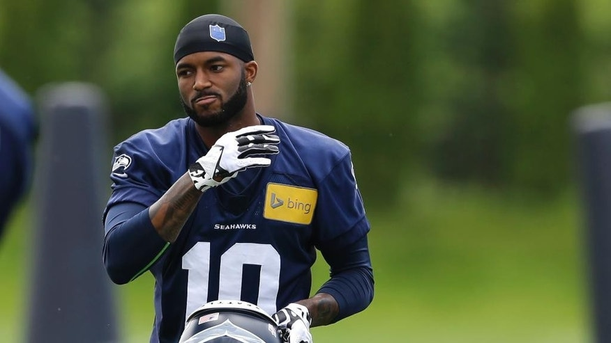 Seattle Seahawks rookie wide receiver Paul Richardson takes a break from practice drills, Friday, May 16, 2014, during NFL football rookie minicamp in Renton, Wash. (AP Photo/Ted S. Warren)