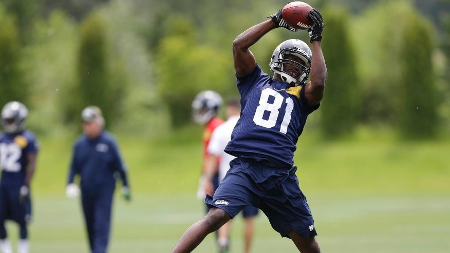 Seattle Seahawks wide receiver Kevin Norwood makes a catch, Friday, May 16, 2014, during an NFL football rookie minicamp in Renton, Wash. (AP Photo/Ted S. Warren)