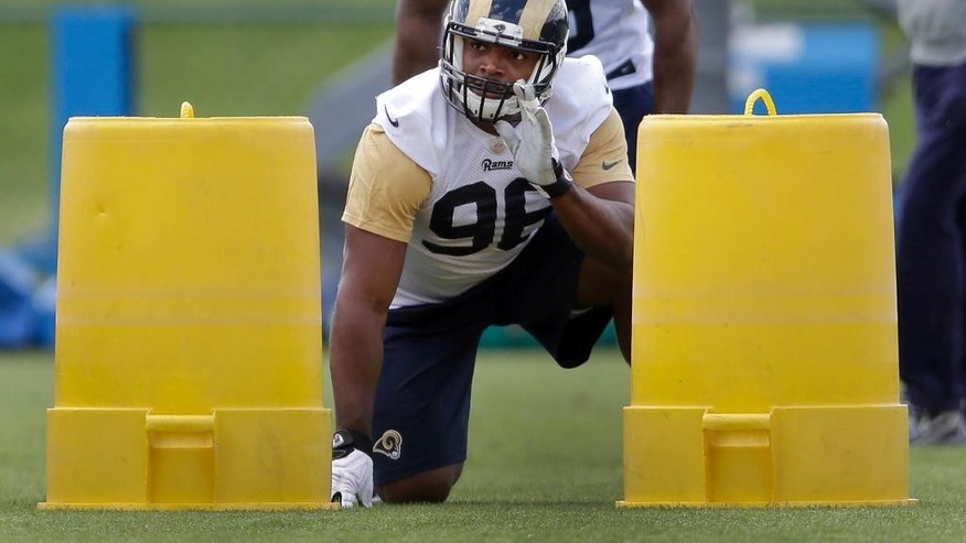 St. Louis Rams seventh-round draft pick Michael Sam takes part in a drill during the team's NFL football rookie camp  Friday, May 16, 2014, in St. Louis. (AP Photo/Jeff Roberson)
