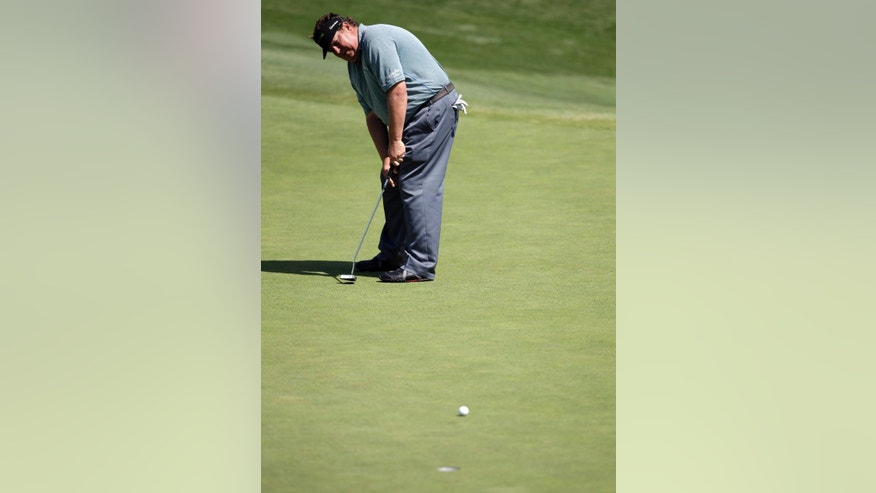 Tim Herron putts on the sixth green during the second round of the Byron Nelson Championship golf tournament, Friday, May 16, 2014, in Irving, Texas. Herron finished the round at 6-under par. (AP Photo/Tony Gutierrez)