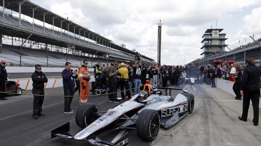 Driver Kurt Busch heads on to the track to begin his qualification attempt on the first day of qualifications for Indianapolis 500 IndyCar auto race at the Indianapolis Motor Speedway in Indianapolis, Saturday, May 17, 2014. (AP Photo/Darron Cummings)
