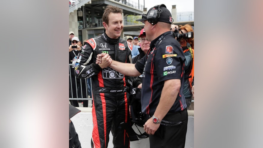 Kurt Busch, left, is congratulated by a member of his crew after he qualified for the second time on the first day of qualifications for Indianapolis 500 IndyCar auto race at the Indianapolis Motor Speedway in Indianapolis, Saturday, May 17, 2014. (AP Photo/AJ Mast)