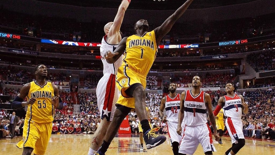 Indiana Pacers guard Lance Stephenson (1) heads toward the basket past Washington Wizards center Marcin Gortat from Poland, center left, during the first half in Game 6 of an Eastern Conference semifinal NBA basketball playoff series in Washington, Thursday, May 15, 2014. (AP Photo/Alex Brandon)