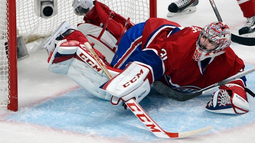Montreal Canadiens goalie Carey Price (31) lets in the fourth goal against the New York Rangers during the second period in Game 1 of the Eastern Conference finals in the NHL hockey Stanley Cup playoffs against in Montreal on Saturday, May 17, 2014. (AP Photo/The Canadian Press, Adrian Wyld)