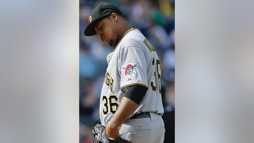 Pittsburgh Pirates starting pitcher Edinson Volquez reacts after giving up a solo home run to New York Yankees' Zoilo Almonte (24) during the third inning of a baseball game, Saturday, May 17, 2014, in New York. (AP Photo/Julie Jacobson)
