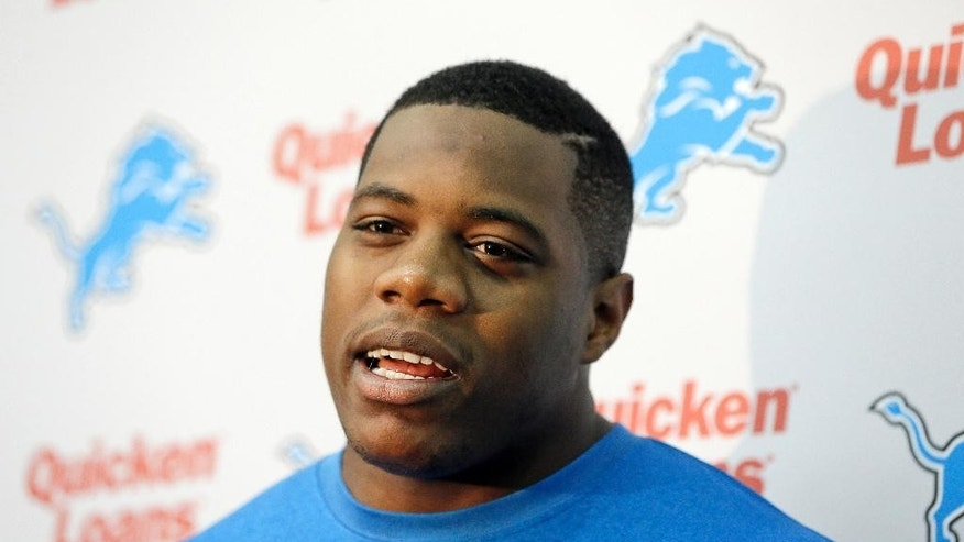 FILE - In this May 16, 2014 file photo, Detroit Lions defensive tackle Caraun Reid is interviewed by the media during the Lions rookie camp in Allen Park, Mich. Reid is named after the doctor who delivered him. He doesn't wear glasses during games because he's more aggressive without them. He also comes with a Princeton pedigree. The Lions are hoping this fifth-round pick can become a solid contributor on the defensive line.  (AP Photo/Carlos Osorio, File)
