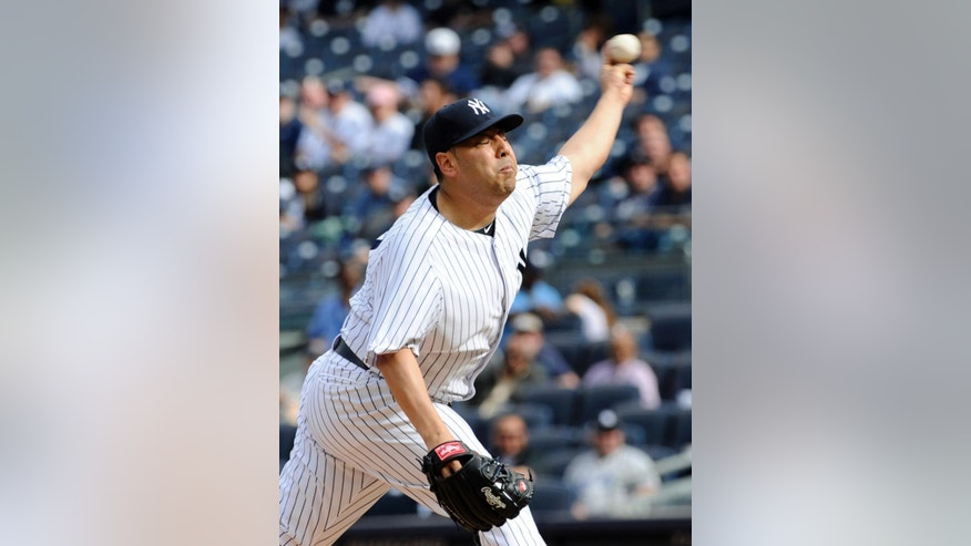 New York Yankees pitcher Vidal Nuno delivers the ball to the Pittsburgh Pirates during the first inning of the second game of a baseball double-header Sunday, May 18, 2014, at Yankee Stadium in New York. (AP Photo/Bill Kostroun)