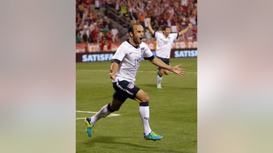 FILE - In this Sept. 10, 2013, file photo, United States' Landon Donovan celebrates after scoring a goal against Mexico during the second half of a World Cup qualifying soccer match in Columbus, Ohio. Donovan hasn't just resurrected his career with the U.S. team, he may be the Americans' most important player. (AP Photo/Jay LaPrete, File) - YOU CAN FIND THE ENTIRE  WORLD CUP COLLECTION ON APIMAGES.COM