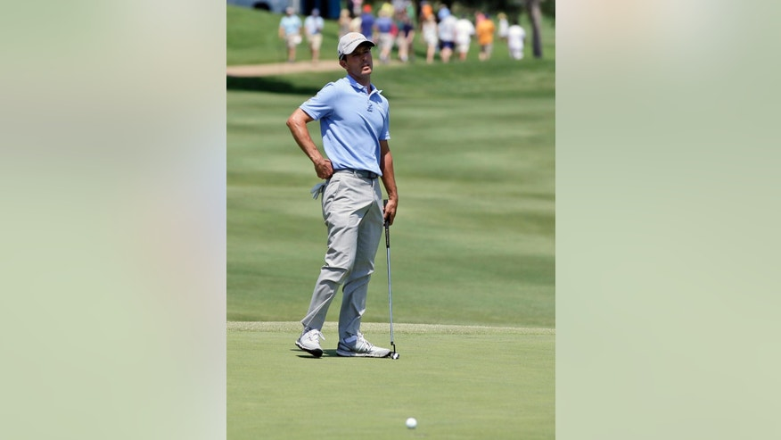 Mike Weir reacts after his birdie attempt on the 11th green stops short during the final round of the Byron Nelson Championship golf tournament, Sunday, May 18, 2014, in Irving, Texas. Weir finished the tournament in second place, two strokes behind leader Brendon Todd. (AP Photo/Tony Gutierrez)