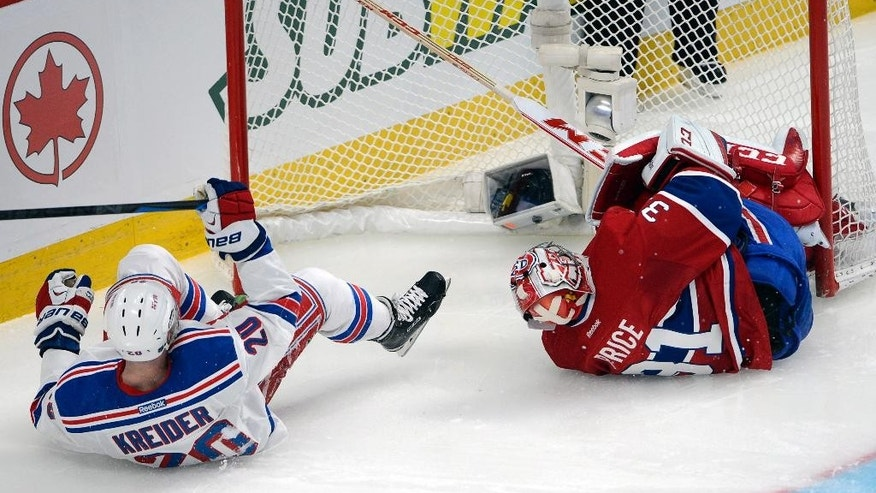 In this May 17, 2014 photo, New York Rangers left wing Chris Kreider (20) falls after crashing into Montreal Canadiens goalie Carey Price (31) during the second period in game one of the National Hockey League Eastern Conference final Stanley Cup playoffs  in Montreal. Price's status for Game 2 of the Eastern Conference final is still unclear. Price briefly tested his right knee Sunday before the Canadiens' optional practice. Coach Michel Therrien said the team will know more Monday before they host the New York Rangers trailing 1-0 in the series. (AP Photo/The Canadian Press, Ryan Remiorz)