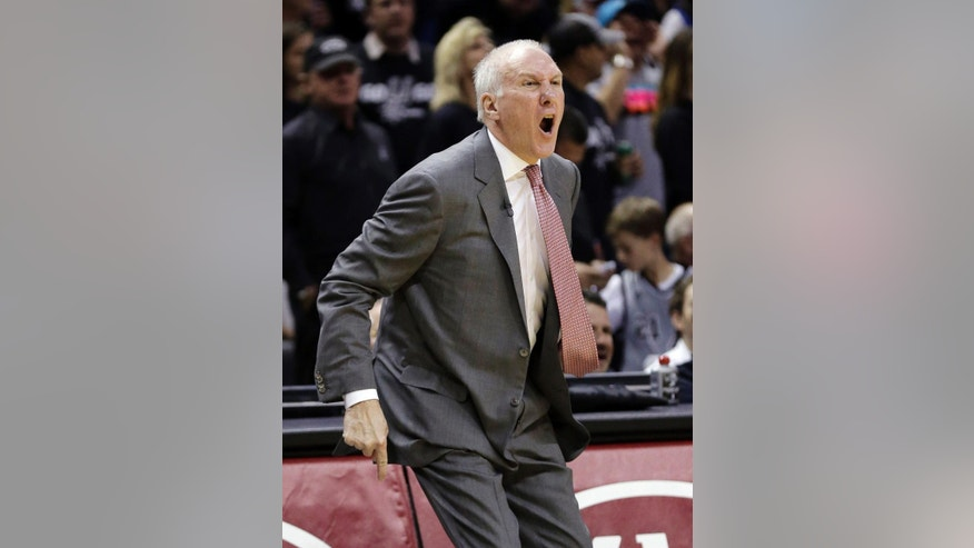 San Antonio Spurs coach Gregg Popovich argues a call during the first half of Game 1 of a Western Conference finals NBA basketball playoff series against the Oklahoma City Thunder, Monday, May 19, 2014, in San Antonio. (AP Photo/Eric Gay)