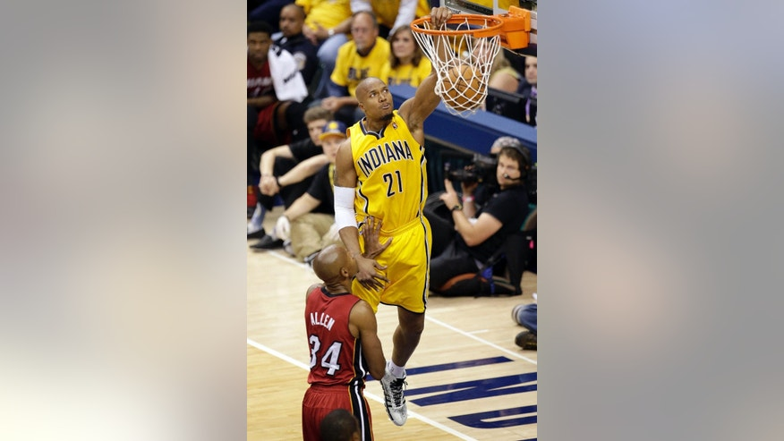 Indiana Pacers forward David West (21) dunks in front of Miami Heat guard Ray Allen (34) during the second half of Game 1 of the Eastern Conference finals NBA basketball playoff series, Sunday, May 18, 2014, in Indianapolis.The pacers won 107-96. West had 19 points. (AP Photo/AJ Mast)