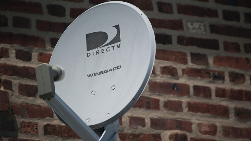A DirecTV dish is seen outside a home in the Queens borough of New York July 29, 2013.
