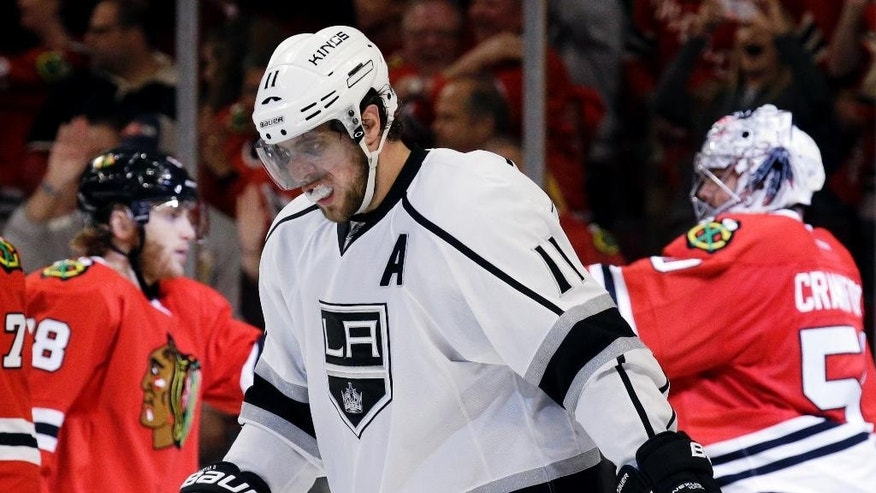 Los Angeles Kings' Anze Kopitar (11) reacts as he leaves the ice after his team's 3-1 loss to the Chicago Blackhawks in Game 1 of the Western Conference finals in the NHL hockey Stanley Cup playoffs in Chicago on Sunday, May 18, 2014. The Blackhawks won 3-1. (AP Photo/Nam Y. Huh)