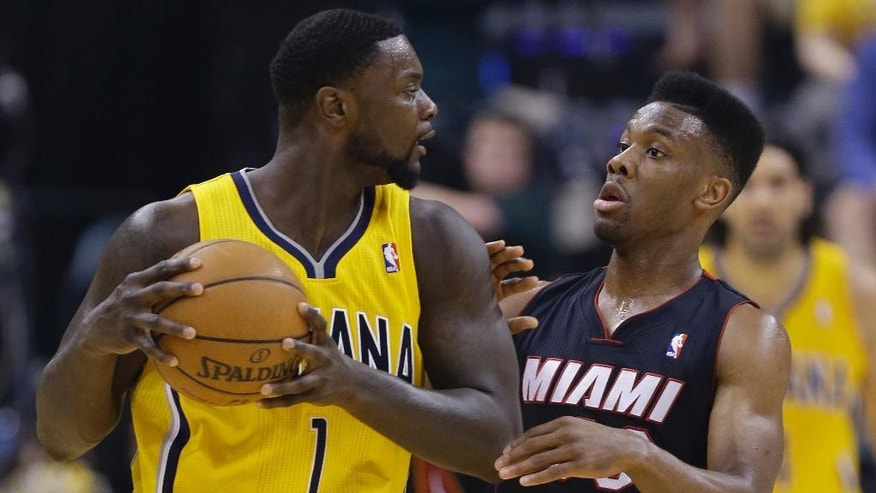 Indiana Pacers' Lance Stephenson is defended by Miami Heat's Norris Cole during the first half of Game 2 of the NBA basketball Eastern Conference finals in Indianapolis, Tuesday, May 20, 2014. (AP Photo/Michael Conroy)