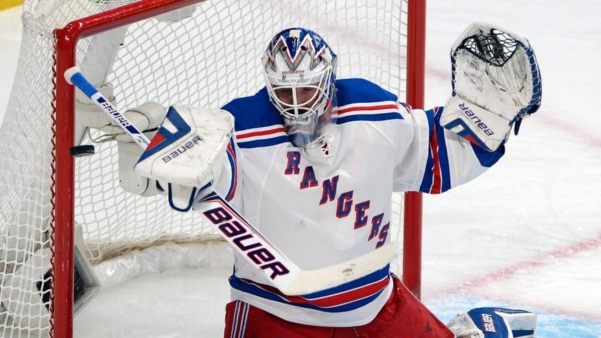 New York Rangers goalie Henrik Lundqvist makes a save against the Montreal Canadiens during the first period in Game 2 of the NHL hockey Eastern Conference final Stanley Cup playoff series Monday, May 19, 2014 in Montreal. (AP Photo/The Canadian Press, Ryan Remiorz)