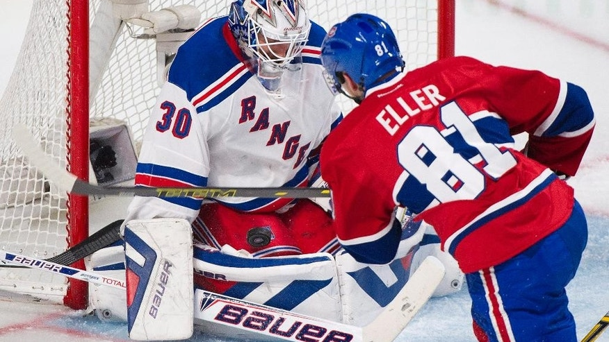 New York Rangers' goaltender Henrik Lundqvist makes a save against Montreal Canadiens' Lars Eller, right, during the second period in Game 2 of the NHL hockey Eastern Conference final Stanley Cup playoff action in Montreal, Monday, May 19, 2014 (AP Photo/The Canadian Press, Graham Hughes)