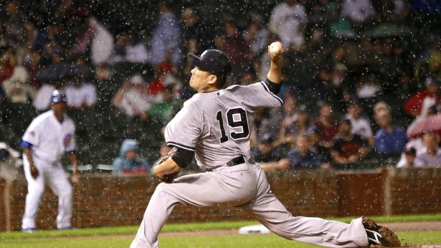 New York Yankees starting pitcher Masahiro Tanaka delivers in a steady rain during the third inning of an interleague baseball game against the Chicago Cubs on Tuesday, May 20, 2014, in Chicago. (AP Photo/Charles Rex Arbogast)