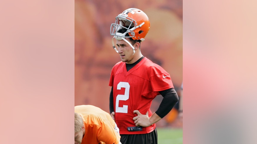 Cleveland Browns quarterback Johnny Manziel (2) waits his turn to run a drill during an off-season practice at the NFL football team's facility in Berea, Ohio Wednesday, May 21, 2014. (AP Photo/Mark Duncan)