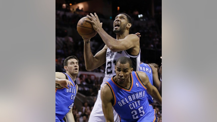 San Antonio Spurs' Tim Duncan (21) shoots over Oklahoma City Thunder's Thabo Sefolosha (25) during the first half of Game 2 of the Western Conference finals NBA basketball playoff series, Wednesday, May 21, 2014, in San Antonio. (AP Photo/Eric Gay)