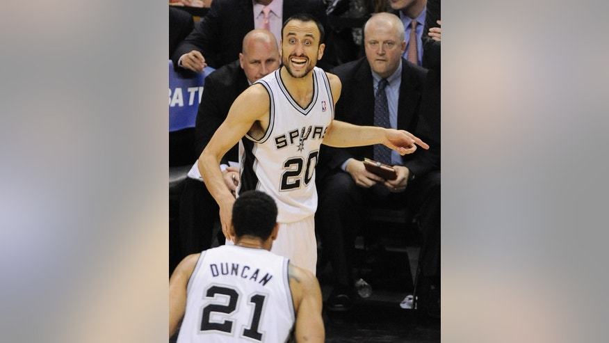 San Antonio Spurs guard Manu Ginobili, rear, of Argentina, talks to Tim Duncan during the second half of Game 2 of the Western Conference finals NBA basketball playoff series against the Oklahoma City Thunder, Wednesday, May 21, 2014, in San Antonio. San Antonio won 112-77. (AP Photo/Darren Abate)