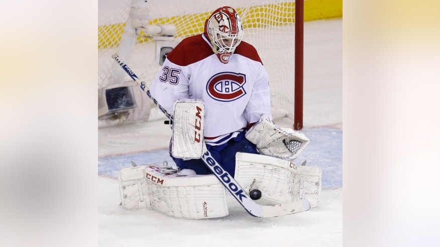 Montreal Canadiens goalie Dustin Tokarski makes a save during the second period of Game 3 of the NHL hockey Stanley Cup playoffs Eastern Conference finals against the New York Rangers, Thursday, May 22, 2014, in New York. (AP Photo/Seth Wenig)