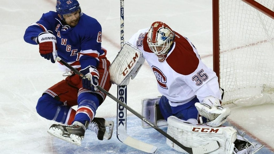 Montreal Canadiens goalie Dustin Tokarski, right, blocks a shot by New York Rangers' Rick Nash during the first period of Game 3 of the NHL hockey Stanley Cup playoffs Eastern Conference finals, Thursday, May 22, 2014, in New York. (AP Photo/Seth Wenig)