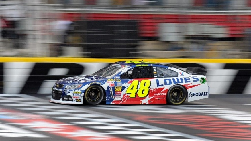 Jimmie Johnson drives during qualifying for Sunday's NASCAR Sprint Cup series auto race at Charlotte Motor Speedway in Concord, N.C., Thursday, May 22, 2014. Johnson won the pole position. (AP Photo/Mike McCarn)