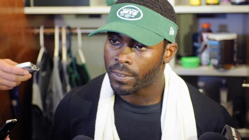 New York Jets NFL football quarterback Michael Vick speaks to the media Thursday, May 22, 2014, in Florham Park, N.J. (AP Photo/Bill Kostroun)