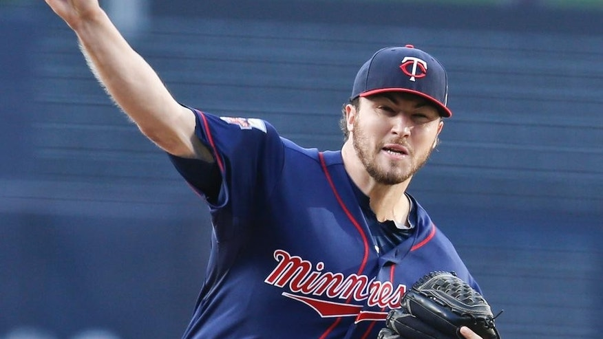 Minnesota Twins  starter Phil Hughes works against the San Diego Padres during the first inning of a baseball game Wednesday, May 21, 2014, in San Diego.  (AP Photo/Lenny Ignelzi)
