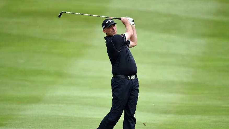 Denmark's Thomas Bjorn  plays a shot from the fairway during day one of the BMW PGA Championship at the Wentworth Club,  Virginia Water England Thursday May 22, 2014. Bjorn shot a 10-under-par 62 in the first round.(AP PhotoAdam Davy/PA) UNITED KINGDOM OUT