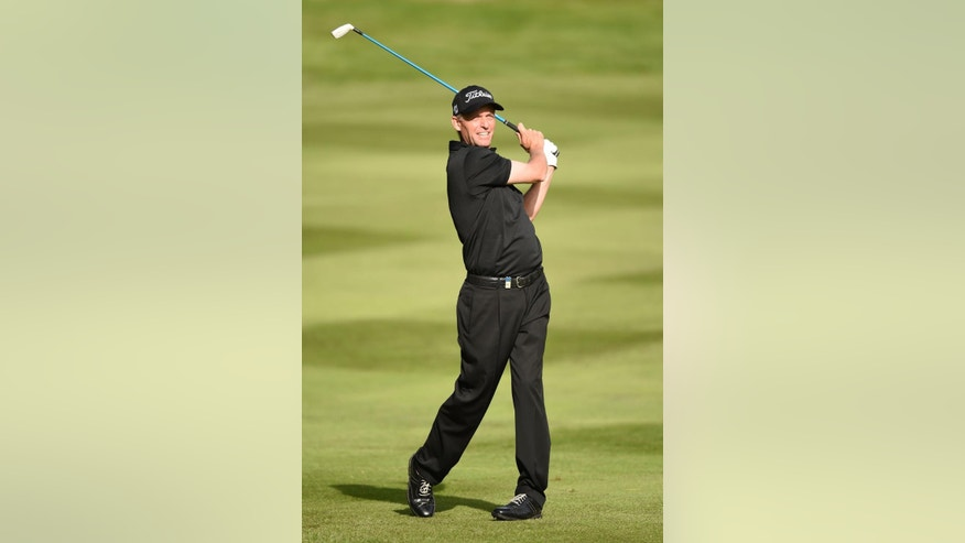 Sweden's Peter Hanson swings the club during day one of the BMW PGA Championship at the Wentworth Club,  Virginia Water England Thursday May 22, 2014. (AP Photo/Adam Davy/PA) UNITED KINGDOM OUT