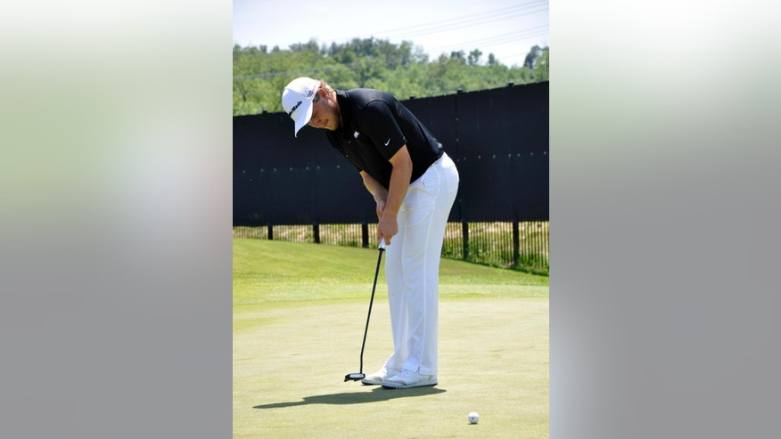 In this photo taken May 20, 2014, Arkansas golfer Sebastian Cappelen practices his putting at the team's practice facility at the Blessings Golf Course in Johnson, Ark. The senior is a three-time All-American for the Razorbacks, and hopes to end his career with a win at this weekend's NCAA golf championship in Hutchinson, Kansas. (AP Photos/Kurt Voigt)