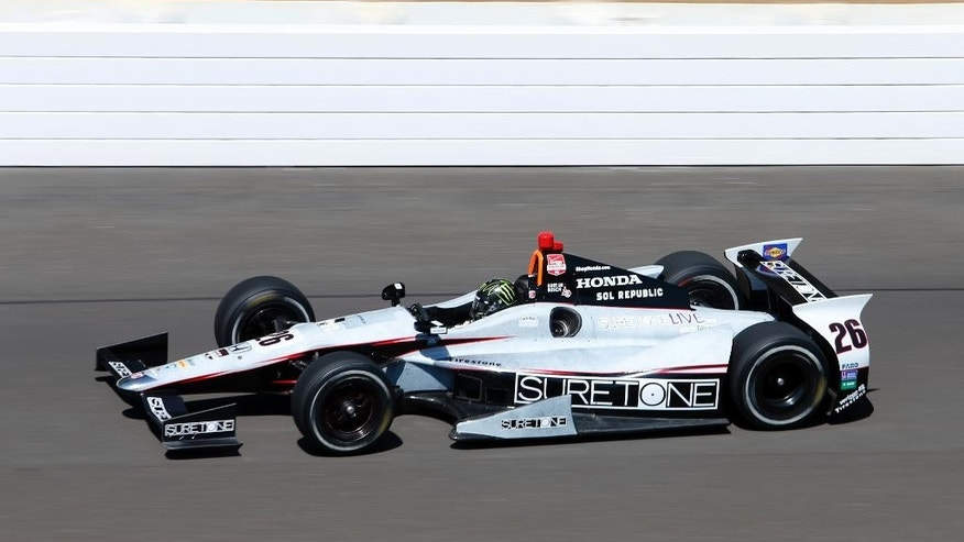 Kurt Busch heads into the first turn on the final day of practice for the Indianapolis 500 IndyCar auto race at the Indianapolis Motor Speedway in Indianapolis, Friday, May 23, 2014. The 98th running of the Indianapolis 500 is Sunday. (AP Photo/Tom Strattman)