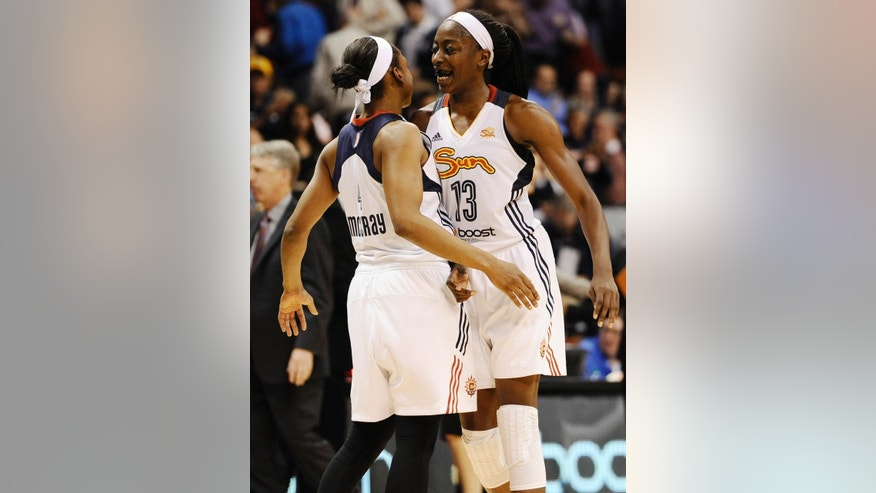 Connecticut Sun's Chiney Ogwumike, right, celebrates with Danielle McCray at the end of a WNBA basketball game against the Seattle Storm, Friday, May 23, 2014 in Uncasville, Conn. The Sun defeated the Storm 71-59. (AP Photo/Jessica Hill)