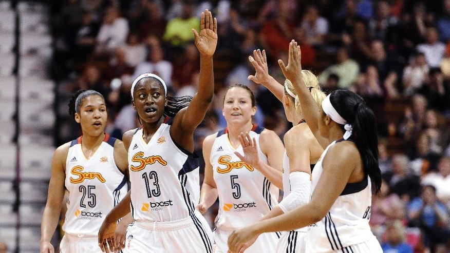 Connecticut Sun's Chiney Ogwumike (13) reaches to her teammates for a high-five during the second half of a WNBA basketball game against the Seattle Storm, Friday, May 23, 2014 in Uncasville, Conn. Ogwumike was top scorer for the Sun with 18 points as the Sun defeated the Storm 71-59. (AP Photo/Jessica Hill)