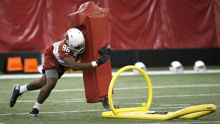 Arizona Cardinals third-round draft pick Kareem Martin participates in team workouts during an NFL rookie football minicamp, Friday, May 23, 2014, in Tempe, Ariz. (AP Photo/Matt York)