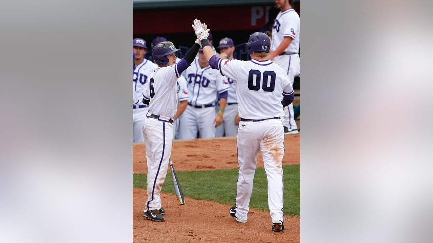 TCU's Kyle Bacak, left, and Kevin Cron, right, celebrate after scoring runs in the sixth inning of the championship game against Oklahoma State in the Big 12 conference NCAA college baseball tournament in Oklahoma City, Sunday, May 25, 2014. (AP Photo/Alonzo Adams)