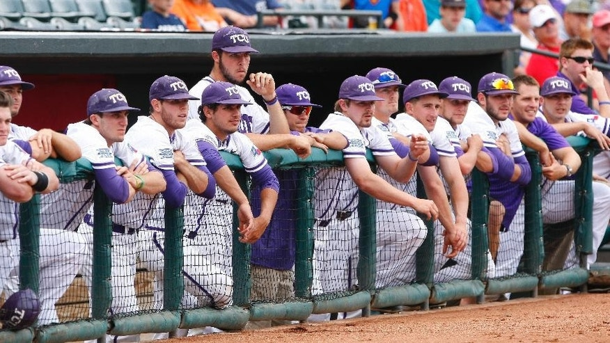 The TCU dugout watches a play in the first inning of the championship game against Oklahoma State in the Big 12 conference NCAA college baseball tournament in Oklahoma City, Sunday, May 25, 2014. (AP Photo/Alonzo Adams)