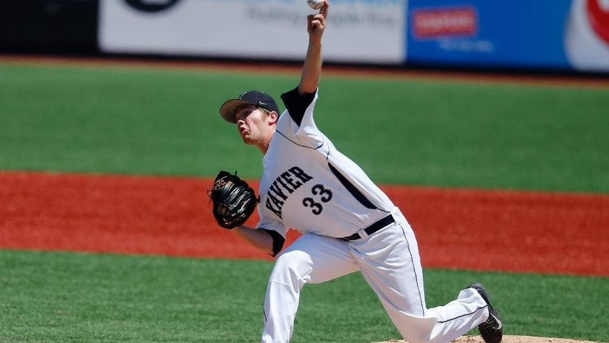 Xavier's Trent Astle delivers during the second inning of an NCAA college baseball game against Creighton in the championship round of the Big East conference tournament, Sunday, May 25, 2014, in New York. Xavier won 5-0. (AP Photo/Jason DeCrow)