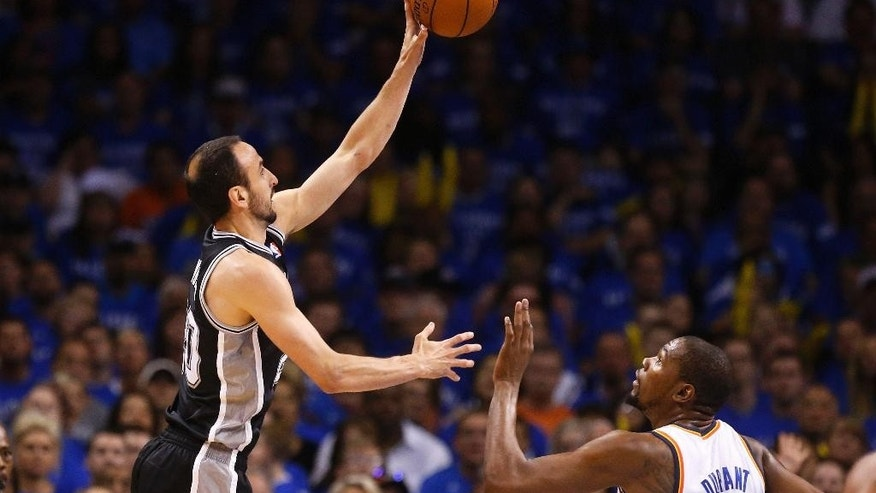 San Antonio Spurs guard Manu Ginobili shoots over Oklahoma City Thunder forward Kevin Durant (35) in the first quarter of Game 3 of an NBA basketball playoff series in the Western Conference finals, Sunday, May 25, 2014, in Oklahoma City. (AP Photo/Sue Ogrocki)