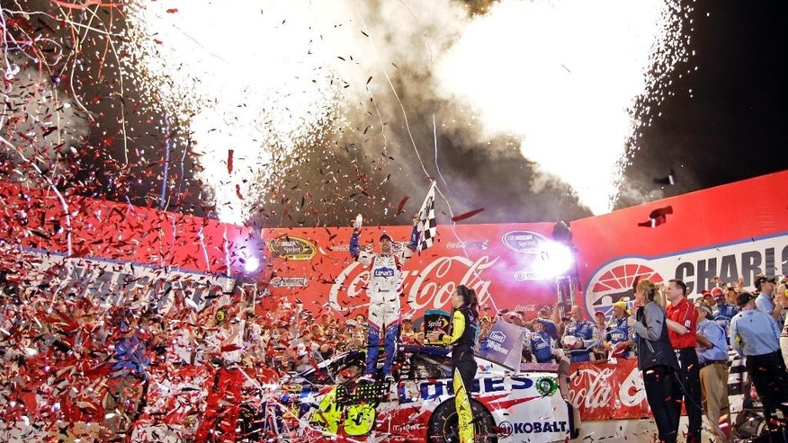 Driver Jimmie Johnsoon, center, celebrates in Victory Lane after winning the NASCAR Sprint Cup series Coca-Cola 600 auto race at Charlotte Motor Speedway, Sunday, May 25, 2014, in Concord, N.C. (AP Photo/Chuck Burton)