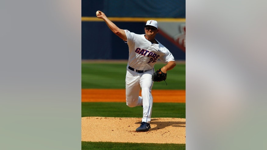 Florida's Karsten Whitson (22) pitches against LSU during the first inning at the Southeastern Conference NCAA college baseball tournament on Sunday, May 25, 2014, in Hoover, Ala. (AP Photo/Butch Dill)