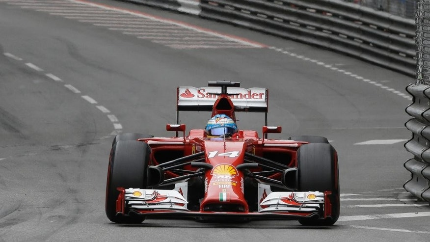 Ferrari driver Fernando Alonso of Spain steers his car during the Monaco Formula One Grand Prix, at the Monaco racetrack, in Monaco, Sunday, May 25, 2014. (AP Photo/Luca Bruno)