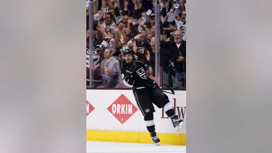 Los Angeles Kings defenseman Drew Doughty celebrates his goal against the Chicago Blackhawks during the third period of Game 3 of the Western Conference finals of the NHL hockey Stanley Cup playoffs in Los Angeles, Saturday, May 24, 2014. (AP Photo/Chris Carlson)