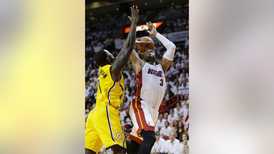 Miami Heat guard Dwyane Wade (3) drives to the basket as Indiana Pacers guard Lance Stephenson defends during the second half of Game 3 in the NBA basketball Eastern Conference finals playoff series, Saturday, May 24, 2014, in Miami. (AP Photo/Lynne Sladky)
