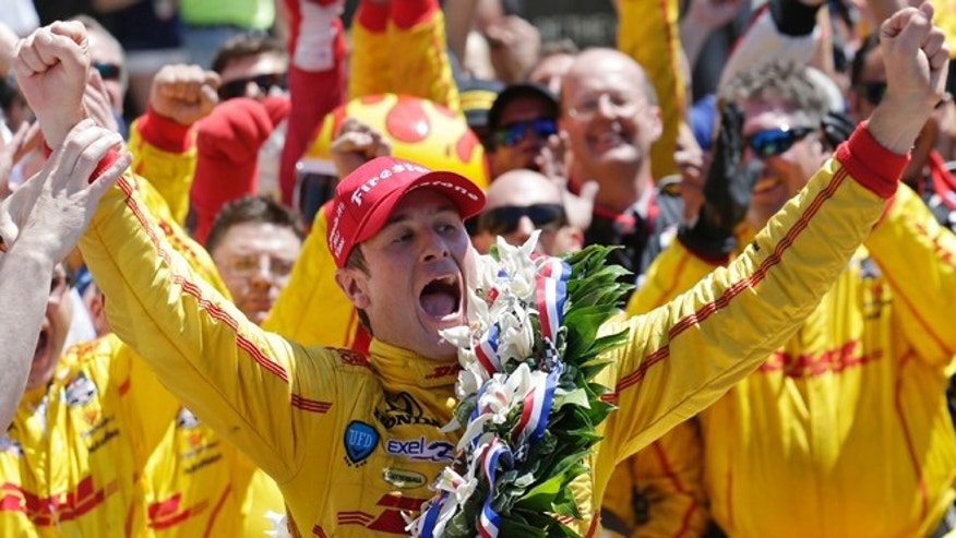 May 25, 2014: Ryan Hunter-Reay celebrates winning the 98th running of the Indianapolis 500 IndyCar auto race at the Indianapolis Motor Speedway in Indianapolis.