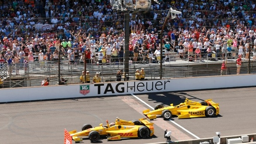 May 25, 2014: Ryan Hunter-Reay celebrates after crossing the finish line take the checkered flag in front of Helio Castroneves, of Brazil, to win the 98th running of the Indianapolis 500 IndyCar auto race at the Indianapolis Motor Speedway in Indianapolis.